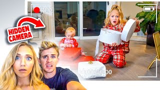 Hidden Camera Catches Ev and Posie Sneaking Their Christmas Presents Early...