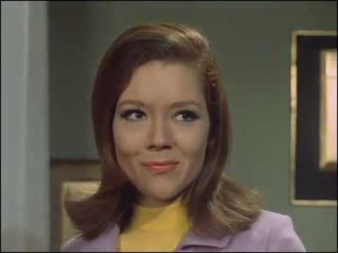 Youtube video - Mrs Peel wakes from a nap to find a toy carousel on her table. One of the knights bears a flag that reads 'MRS PEEL'. Steed appears and says, 'We're needed!'