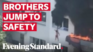 Two boys jump off building to escape massive fire, video g..