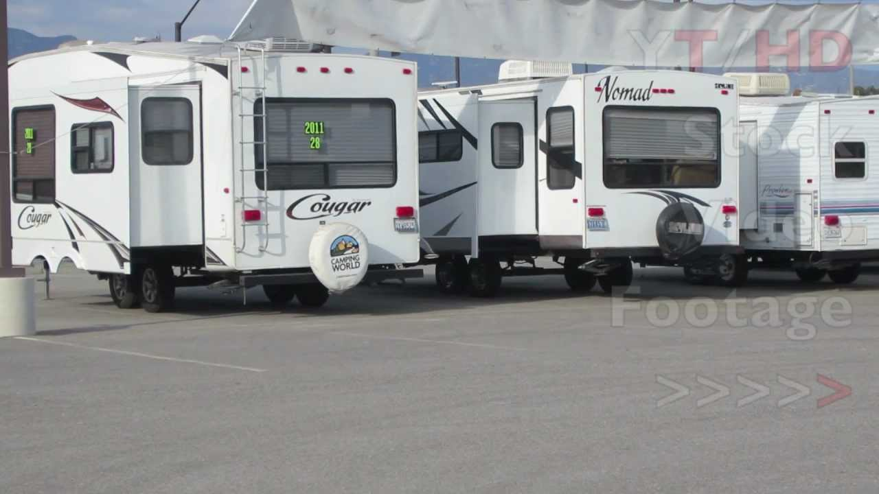 used travel trailers for sale from small lightweight campers to 5th wheels hd stock video. Black Bedroom Furniture Sets. Home Design Ideas