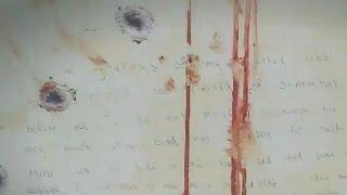 Jurors see Tsarnaev note written inside hideout boat