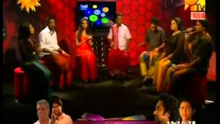 Sachithra Senanayake singing on a TV show in Sri Lanka