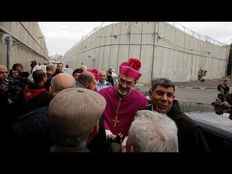 Christmas Eve crowds flock to Bethlehem