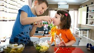 Making fruit salad, a salad of bananas, kiwi, pineapples and apples, Dara makes a salad