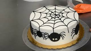 How to Decorate a Halloween Cake With Spider Web