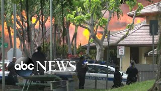 Man kills 2 officers, burns 7 homes to the ground