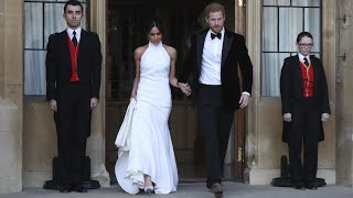 Duke and Duchess of Sussex depart in Jaguar for wedding reception