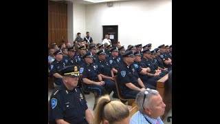 Police officers fill courtroom as murder suspect faces judge