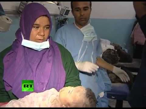 Extremely graphic footage: Libyan children killed by NATO bombs