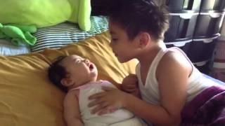 concern brother over crying baby sister....