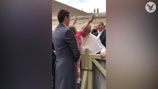 Young girl steals the Pope's hat