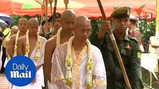 Thai boys are ordained as Buddhist novices to honour rescuer