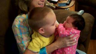 Autistic 2 year old meets his newborn sister (Barking dog NOT ours! Please ignore)