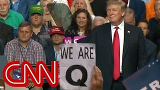 Conspiracy theory group appears at Trump rally
