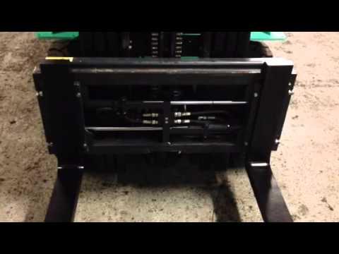 Forklift truck fork positioner