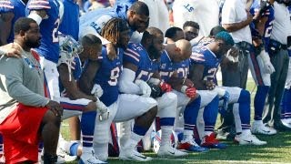 Trump slams NFL players for kneeling during national anthem