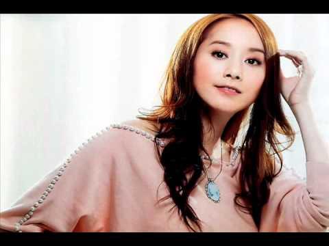 七月七日晴 (Qi Yue Qi Ri Qing) by  Evonne Hsu (许慧欣) with lyrics