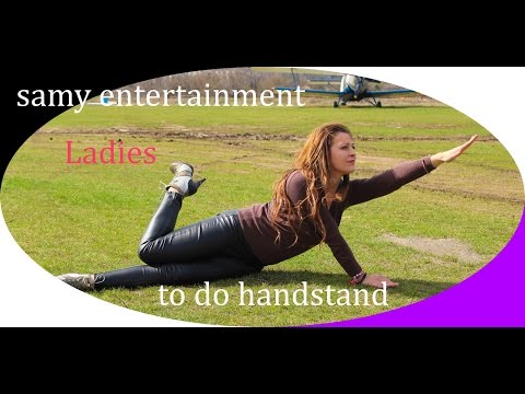 To do handstand in high heels and wetlook leggings