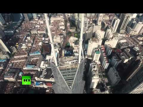 Top of the world: Fearless roofers climb 333 meter-tall Shanghai Spires