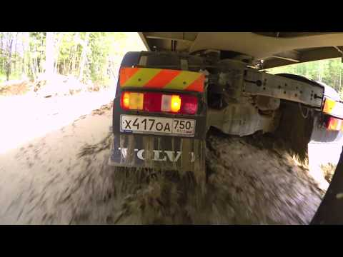 Volvo Trucks ? Running footage of a Volvo FMX navigating through the mud-filled roads in Russia
