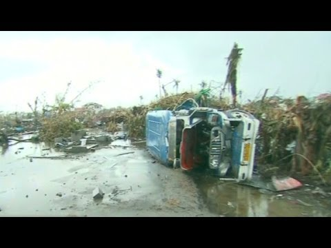 Tacloban: A ravaged city in mourning - CNN  - Q23rvqadKi0 -