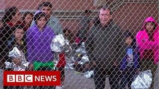 US-Mexico border: Migrants held as Trump threatens closure - BBC News