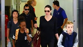 Angelina Jolie And Her Brood Arriving From London