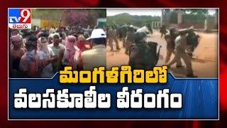 Migrant workers pelt stones at police in Andhra Pradesh..
