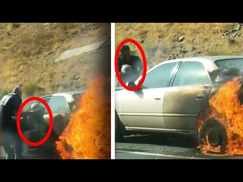 Elderly couple pulled from burning car by group of men