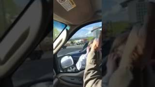 Lady Goes Crazy Waving A Knife And Headbutting The Windows Of A Truck!
