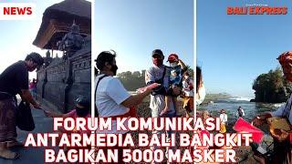 Forkom Antarmedia Bali Bangkit Bagikan Masker di Tanah Lot