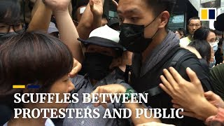 Scuffles between Hong Kong protesters and public