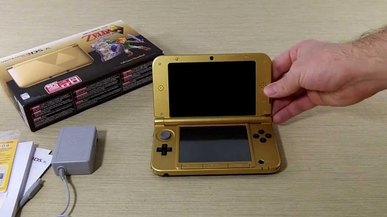 Nintendo 3ds xl gold/black limited edition zelda bundle.