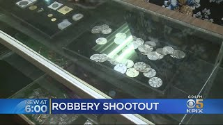 Oakland Business Owner Exchanges Gunfire With Armed Robbers; Stray Bullet Hits Resident Inside Home