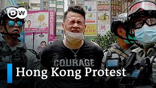 Hong Kong police enforces first arrests under new security law | DW News