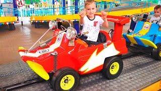 Vlad and Nikita play with Mom at the Amusement Park Family Fun