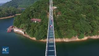 Walking on water: China's first glass bridge across islets opens in Hunan