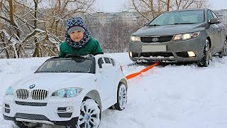FUNNY BABY Stuck in the SNOW! Kid Pretend Play ride on POWER WHEEL Towing car BMW video for kids