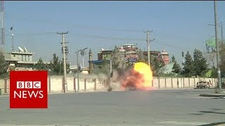 Afghan forces blast TV station wall as they target militants - BBC News