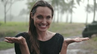 EXCLUSIVE: Angelina Jolie Gets Caught in the Rain Behind the Scenes of 'Unbroken'