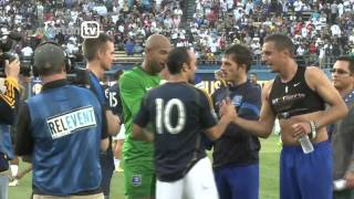 Landon Donovan greets Everton players in LA