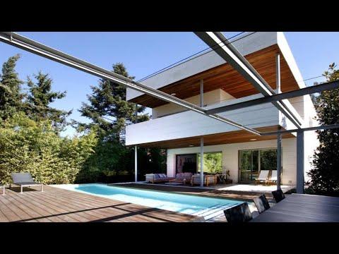 Casa de lujo con jard n piscina y garaje exquisito for Diseno de casas con piscina interior