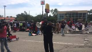 Watch As Protesters Stop Traffic During Flint Minimum Wage Rally