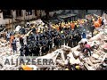 More than 20 die as 117-yr-old building collapses in Mumba..