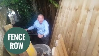 Angry millionaire caught tearing down neighbour's fence