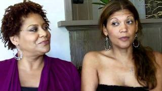 KIM COLES speaks Spanish with her amiga AIDA RODRIGUEZ