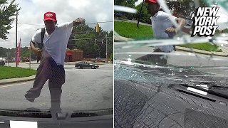 Attacker jumps on woman's windshield and kicks it in for no reason | New York Post