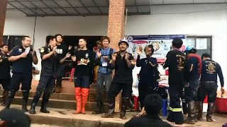 Thai volunteers celebrate after cave rescue