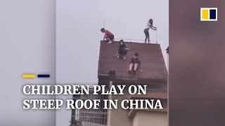 Kids play on steep roof of 32-storey building in China..