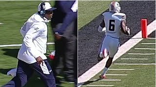 Jackson State coach Deion Sanders runs with his receiver Baldwin on 64-yard touchdown